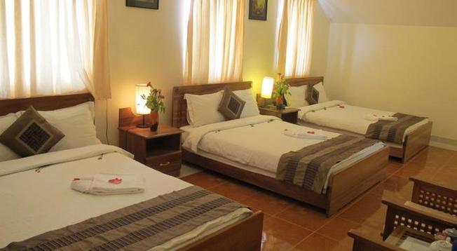 Phòng ngủ tại khách sạn Trung Cang có diện tích lớn