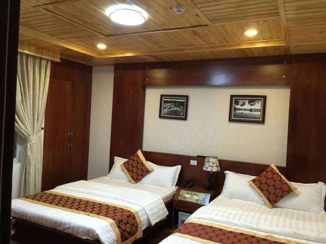 Phòng nghỉ ấm áp, gần gũi của khách sạn Lê Na