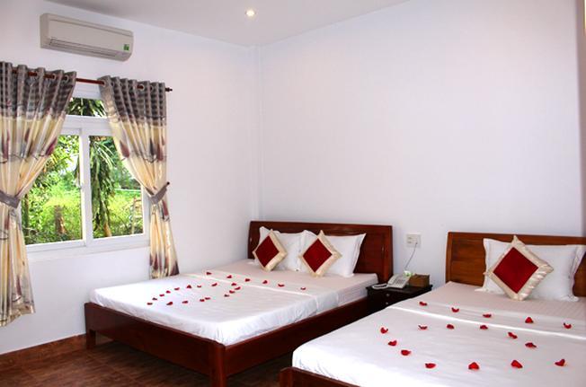 Phòng nghỉ có tầm nhìn ra vườn xanh